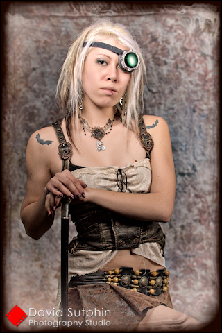 Portrait of Krystalle in Steampunk costume with cane.